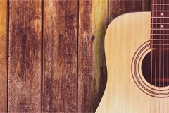 Classical acoustic guitar on wooden background. Classic guitar acoustic yellow white background object Stock Images