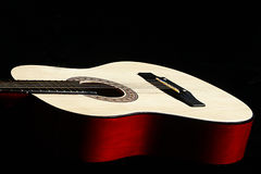 Classic guitar against black background Royalty Free Stock Photo