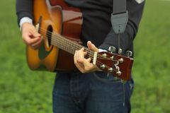 Classic guitar. Beautiful classic guitar in hands of young man stock photography