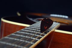 Classic guitar on black. Background Stock Photography