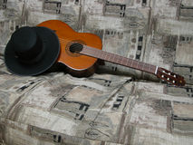 Classic Guitar and Black Hat Stock Image