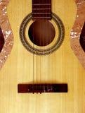 Classic guitar body. On dark background royalty free stock photo