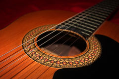 Classic Guitar. Close up Classic Guitar at the red background Stock Photos