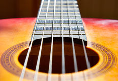 Classic guitar. A closeup with the strings, frets and sound hall of a classic guitar Royalty Free Stock Photos
