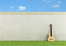 Classic guitar in a garden Stock Photography