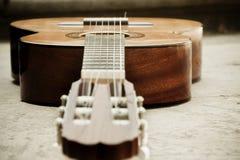 Classic guitar on the ground. Focus on bridge Royalty Free Stock Photos