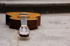 Classic guitar on the ground Stock Image