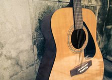 Classic guitar with grunge background Stock Images