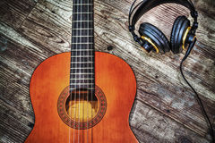 Classic guitar and headphones in hdr Stock Image