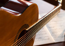 Classic guitar on mucic notes Stock Photos