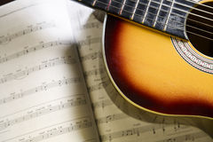 Classic guitar and music chords. Classic guitar on top of music chords Royalty Free Stock Photos