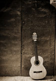 Classic guitar on old door stock photography