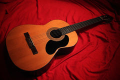 Classic Guitar. At the red background Royalty Free Stock Image