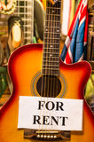 Classic Guitar with Union Jack Flag. Detail of a classic guitar exposed for rent Stock Photography