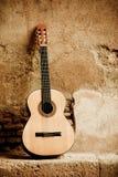 Classic guitar on wall stock photos