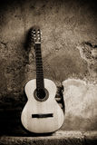 Classic guitar on wall Royalty Free Stock Photography