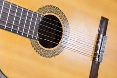 Classic guitar on wood plate and  white background Stock Image