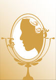 Classic hair-style beautiful woman silhouette in mirror Royalty Free Stock Photo