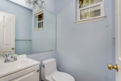 Classic half bathroom with a small window. royalty free stock photography