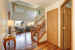 Classic hallway interior with hardwood floor. View of stairs to second floor Stock Photos