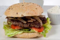 Hamburger bacon onion lettuce tomato tartare sause stock image