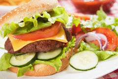 Classic hamburger with cheese, tomato and lettuce Royalty Free Stock Images