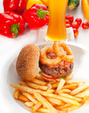 Classic hamburger sandwich and fries Royalty Free Stock Photos