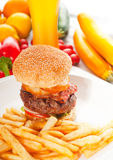 Classic hamburger sandwich and fries Stock Photography