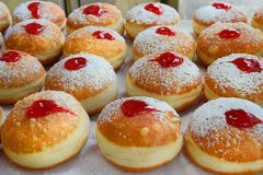Traditional hanukkah sufganiyot with strawberry jelly Stock Photos