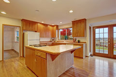 Classic hardwood kitchen with connected living room. Royalty Free Stock Image