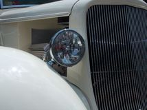 Classic Headlight. The grill view of a white vintage car Royalty Free Stock Photos