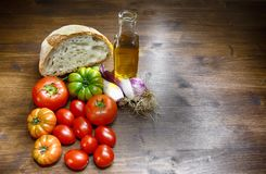 Bread, oil, tomato and Tropea onion. A classic and healthy combination: bread, oil, tomato and onion have a fundamental part in the Mediterranean diet. In the Royalty Free Stock Photos