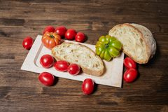 Bread and tomato. A classic and healthy combination: bread and tomato have a fundamental part in the Mediterranean diet. The tomato is native to the area of Royalty Free Stock Images