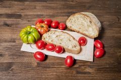 Bread and tomato. A classic and healthy combination: bread and tomato have a fundamental part in the Mediterranean diet. The tomato is native to the area of Royalty Free Stock Photography