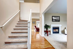 Classic home interior with living room and staircase. Stock Photos