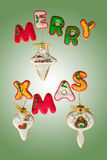 Classic homemade gingerbread Merry Christmas cookies. Merry Christmas cookies on green background Royalty Free Stock Images