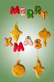 Classic homemade gingerbread Merry Christmas cookies. Merry Christmas cookies on green background Stock Images
