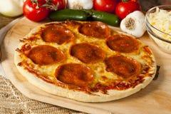 Classic Homemade Italian Pepperoni Pizza Royalty Free Stock Photo