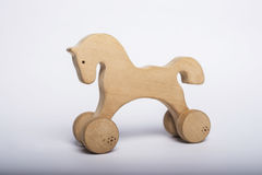 Classic homemade wooden rocking horse on white background. Stock Photo