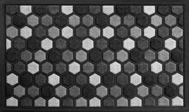 Classic honeycomb Black, Grey and white rubber doormat with black border. Isolated on a White Background stock photography