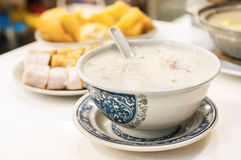 Classic Hong Kong congee served in local cafe. Congee is a classic Asian food. It is a type of rice porridge, seen here in a local Hong Kong cafe Stock Photos