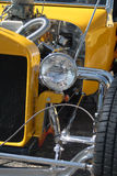 Classic Hot Rod Front. Partial front shot of a yellow classic hot rod vehicle Royalty Free Stock Images