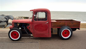 Classic Hot Rod  pickup truck on seafront promenade with sea in background Stock Photos