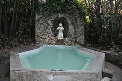 Classic hottub outdoor grotto Tuscan villa Italy Royalty Free Stock Photo