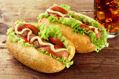 Classic hotdogs with drink of cola on wooden board Royalty Free Stock Photo