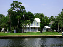 Classic house. On water bank in Florida bay royalty free stock image