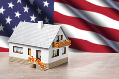 Classic house against USA flag Royalty Free Stock Photography