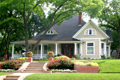 Classic House with flower garden Royalty Free Stock Image