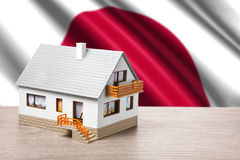 Classic house on Japanese flag background Stock Photo