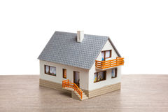 Classic house model. On wooden background Stock Photos